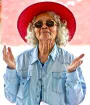 woman wearing red hat and sunglasses
